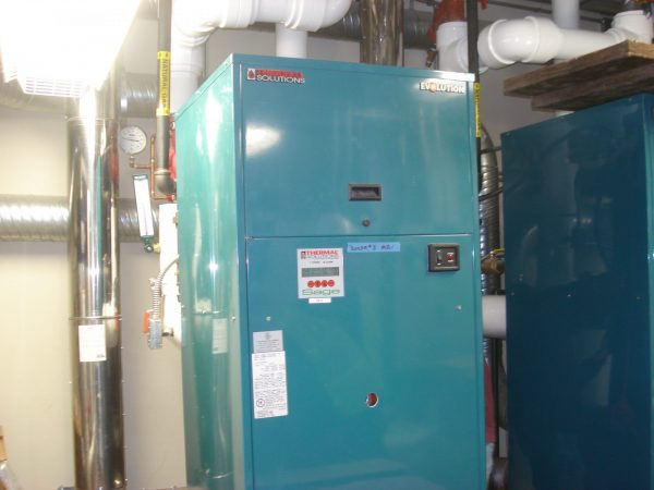 close up of tall light blue industrial boiler