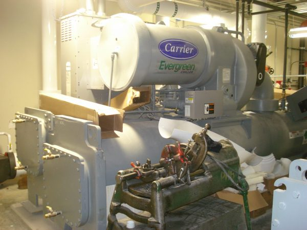 carrier brand grey commercial chiller in utility room