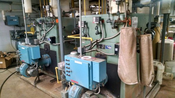 two blue and green industrial boilers